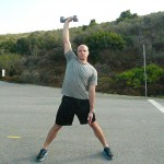 Raise the db/kb above head, feet wide & opposite hand with palm facing up