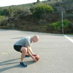 Squat down as you slam ball, scoop hands underneath, pick it up